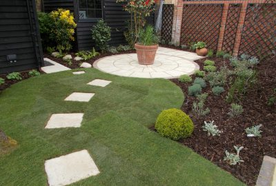 Garden paving stones leading to potted plant