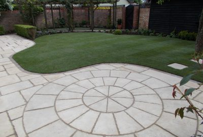 Paved area in garden by lawn