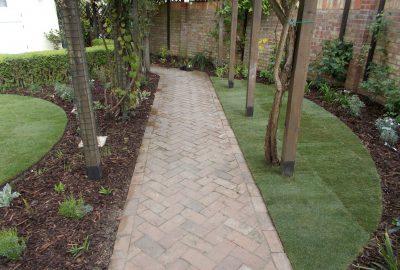 Garden path under wood arches