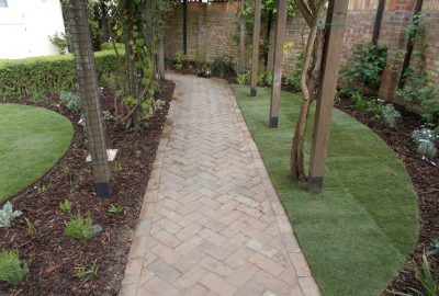 Path going under garden entrances
