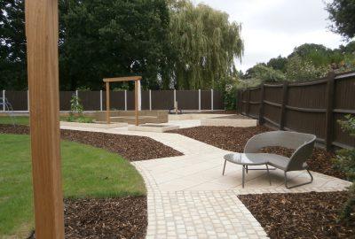 Garden path with wooden entrances