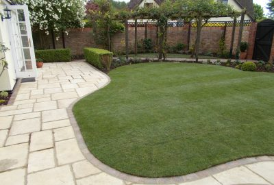 Garden lawn surrounded by paving