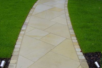 Paved path leading to door