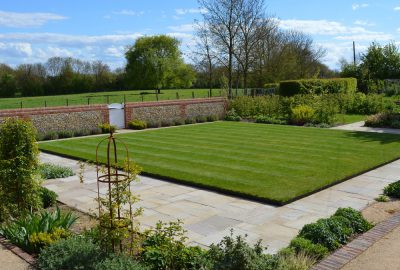 Artificial turf in landscaped garden
