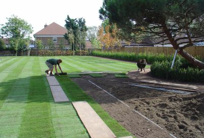 Artificial turf being installed in garden