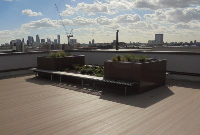 Rooftop garden with plant podiums and benches