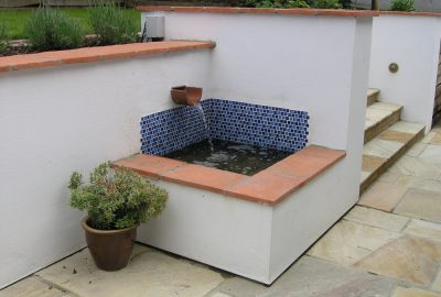 Water feature in corner of garden steps